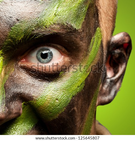 portrait of a furious soldier against a green background - stock photo