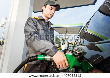 Portrait of a gas station worker - stock photo