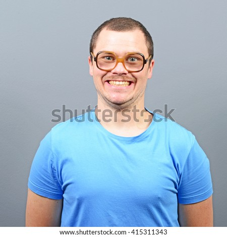 Portrait of a geek looking guy with huge glasses - stock photo
