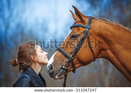 Portrait of a girl and horse  - stock photo