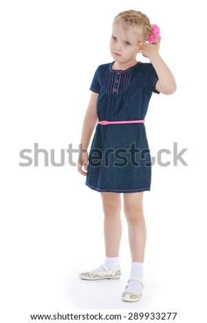 Portrait of a girl-blonde in a blue denim dress - isolated on white background - stock photo