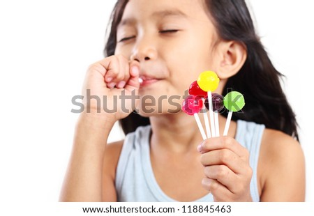 Portrait of a girl eating a lollipop. - stock photo