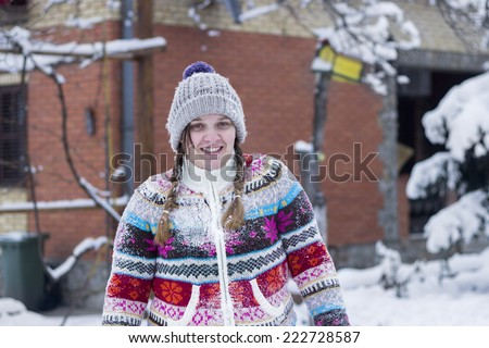 Portrait of a girl enjoying the snowy winter day - stock photo