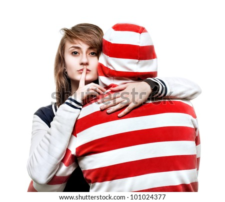 Portrait of a girl hugging a young man in the hood - stock photo