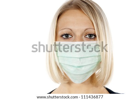 portrait of a girl in a medical mask - stock photo