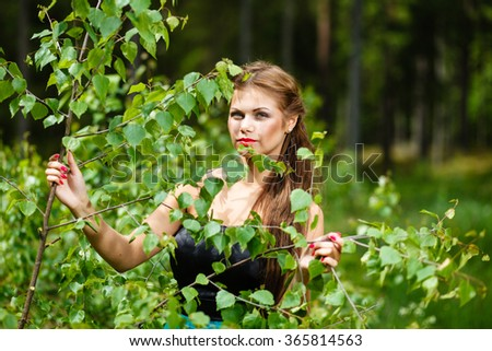 Portrait of a girl in a spring forest. - stock photo
