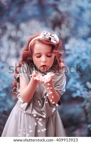portrait of a girl in a spring garden - stock photo
