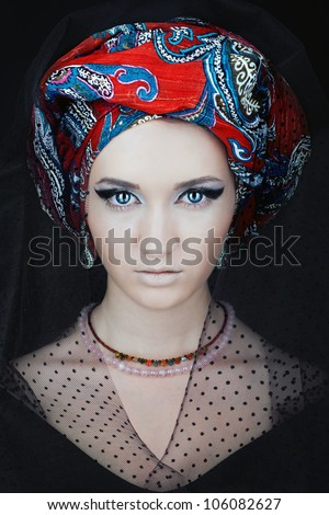 Portrait of a girl in a turban - stock photo