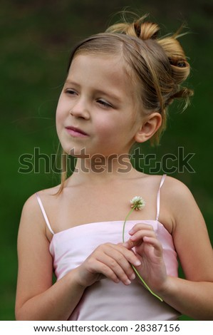 Portrait of a girl in pink dress - stock photo