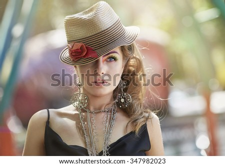 Portrait of a girl model in a beautiful hat. Portrait, style, fashion, beauty. - stock photo