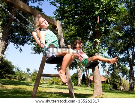 portrait of a girl on swing - stock photo