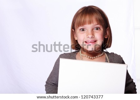 portrait of a girl on white background with room for copy and a white sign - stock photo