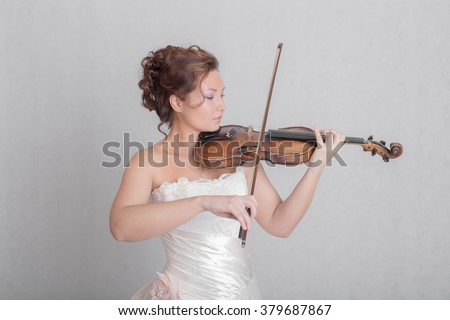 Portrait of a girl playing the violin - stock photo