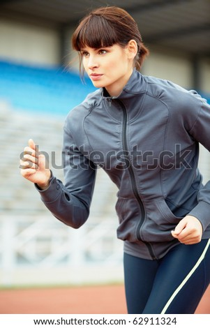 Portrait of a girl running - stock photo