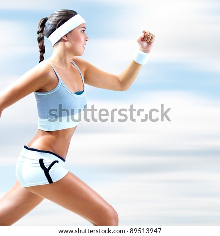 Portrait of a girl running outdoor in summer - stock photo
