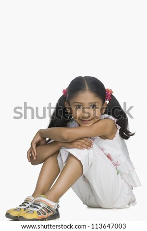 Portrait of a girl smirking - stock photo