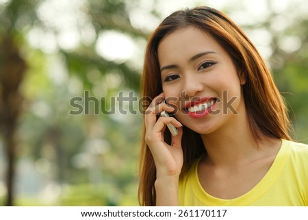 Portrait of a girl talking on the phone - stock photo