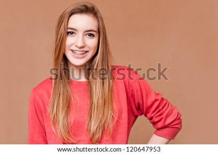 portrait of a girl wearing brace - stock photo