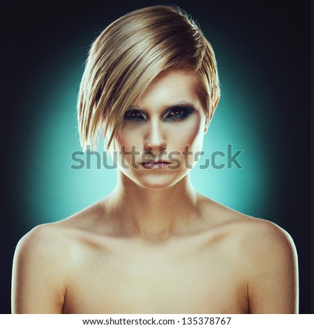 Portrait of a girl with a stern look - stock photo