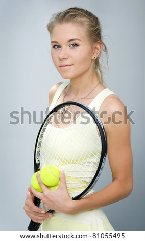 portrait of a girl with a tennis racket and tennis balls - stock photo