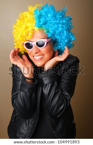 Portrait of a girl with a wig and a hat - stock photo
