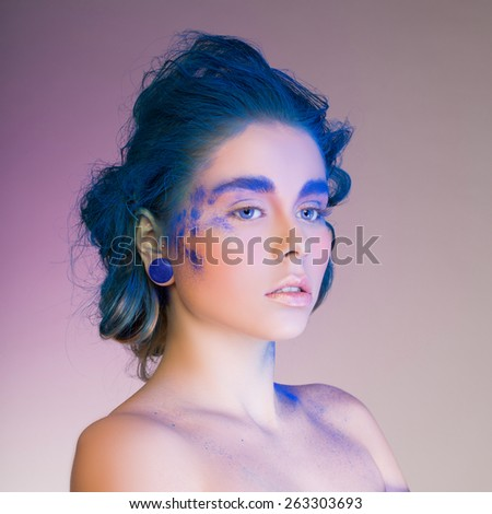 portrait of a girl with an unusual blue make-up - stock photo