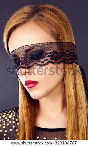 Portrait of a girl with eyes closed in studio tape - stock photo