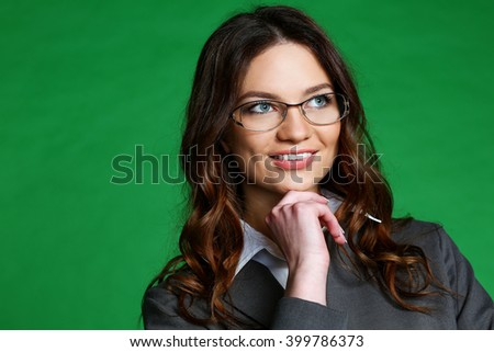 portrait of a girl with glasses on a green background - stock photo