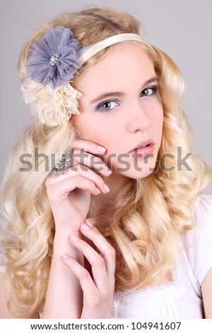 Portrait of a girl with headband and ring - stock photo