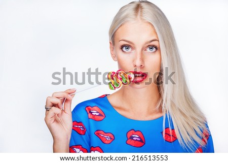 portrait of a girl with lollipop - stock photo