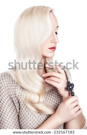 Portrait of a girl with white hair in curls nicely stacked on a white background. - stock photo