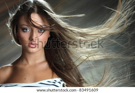 portrait of a girl with wind in her hair - stock photo