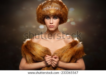 portrait of a glamorous girl in a fur hat - stock photo