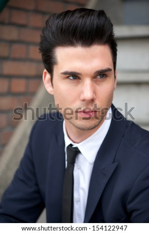 Portrait of a good looking male fashion model in suit - stock photo