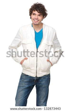 Portrait of a good looking man in white jacket and blue jeans - stock photo
