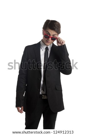 Portrait of a good looking man with shades against the white background - stock photo