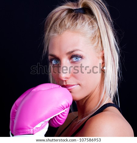 portrait of a good looking woman with boxing gloves - stock photo