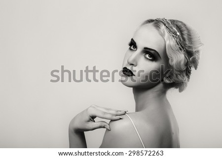 Portrait of a gorgeous blonde. The mystery, sadness, insecurity, human emotions. The girl in the style of the 20s. - stock photo