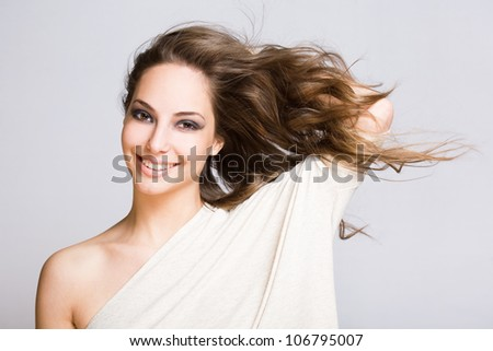 Portrait of a gorgeous relaxed young brunette woman. - stock photo
