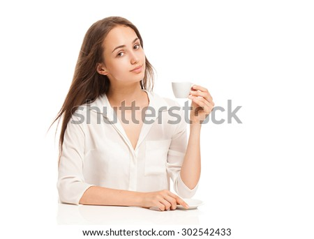 Portrait of a gorgeous young brunette woman having a cup of espresso coffee. - stock photo