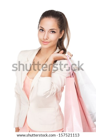Portrait of a gorgeous young brunette woman with pink and white shopping bags. - stock photo