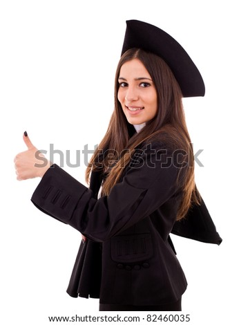 Portrait of a graduating student girl in an academic gown. Isolated over white background. - stock photo