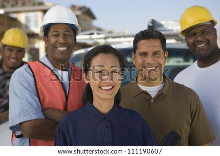Portrait of a group of architects at construction site - stock photo