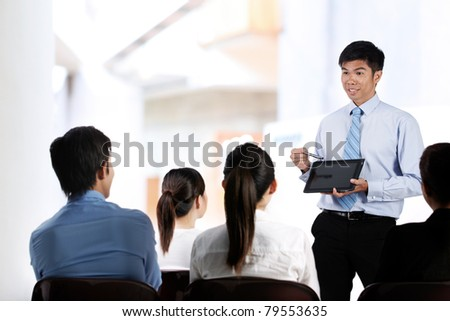 Portrait of a group of Asian businesspeople in meeting - stock photo