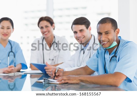 Portrait of a group of young doctors in a meeting at hospital - stock photo