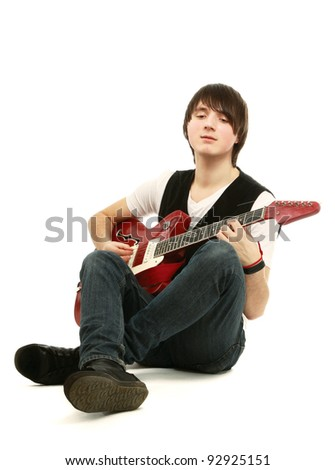 Portrait of a guitarist sitting on the floor, isolated on white background - stock photo