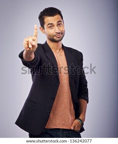 Portrait of a guy gesturing with his hand - stock photo