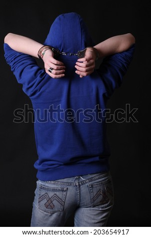 Portrait of a handcuffed - stock photo