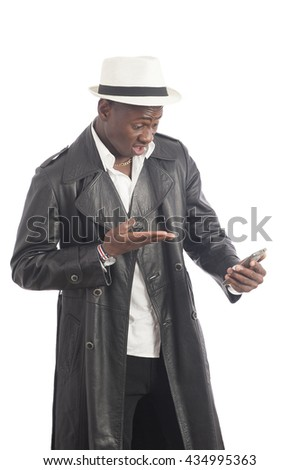 Portrait of a handsome african american man using smartphone over white background - stock photo