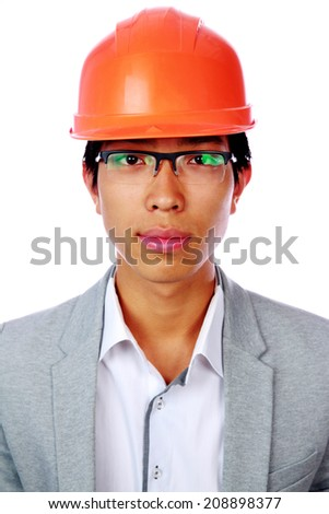Portrait of a handsome asian man in helmet over white background - stock photo